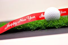 golf-merry-mas-happy-new-year-green-grass-golf-ball-merry-mas-happy-new-year-sign-green-grass-106061134